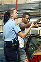 New Orleans police officer Jaimie Cohen makes an arrest, Nov. 17, 2004..(Cheryl Gerber photo)