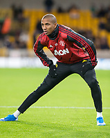 4th January 2020; Molineux Stadium, Wolverhampton, West Midlands, England; English FA Cup Football, Wolverhampton Wanderers versus Manchester United; Ashley Young of Manchester United stretching before the match  - Strictly Editorial Use Only. No use with unauthorized audio, video, data, fixture lists, club/league logos or 'live' services. Online in-match use limited to 120 images, no video emulation. No use in betting, games or single club/league/player publications