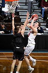 SIOUX FALLS, SD - MARCH 10:  Grant Smith #30 from Indiana Wesleyan takes the ball to the basket against  Zach Imig #12 from Morningside during their quarterfinal game at the 2018 NAIA DII Men's Basketball Championship at the Sanford Pentagon in Sioux Falls. (Photo by Dave Eggen/Inertia)