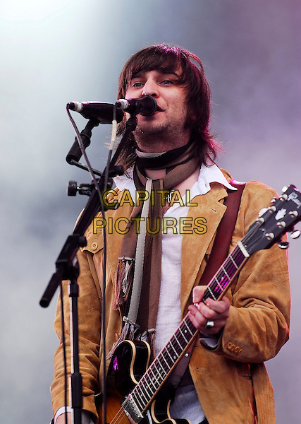 JET - NIC CESTER.Plays live on Day Two of the Hyde Park Calling Music Festival in Hyde Park, London, England. .June 24th 2007.half length stage concert live music gig performance brown jacket guitar singing stubble facial hair .CAP/IA.©Ian Allis/Capital Pictures