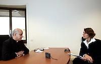 Monsignor Rino Fisichella, a sinistra, durante l'intervista nel suo ufficio con la giornalista Irene Hernandez Velasco, a Roma, 5 novembre 2010..UPDATE IMAGES PRESS/Riccardo De Luca