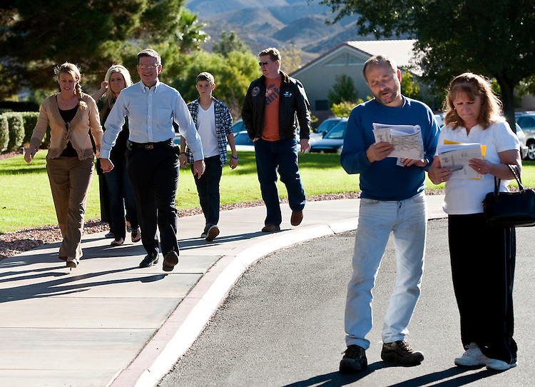 UNITED STATES - NOVEMBER 2: Dr. Joe Heck, Republican candidate running against Rep. Dina Titus, arrives with his family to vote at the Desert Willows Golf Course in Henderson, Nev., on Tuesday, Nov. 2, 2010. (Photo By Bill Clark/Roll Call via Getty Images)