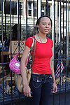 Kia D. Capers, 24, a medical assistant from Chicago on North Milwaukee Avenue in Wicker Park in Chicago, Illinois on June 20, 2009.