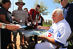 Dodgers' Tommy Lasorda signs autographs before a Cactus League preseason game between the Giants and the Dodgers in Glendale, Ariz., on Tuesday, March 6, 2012. .Photo by Cathleen Allison