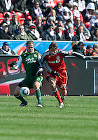 26 March 2011: Toronto FC forward Alan Gordon #21 and Portland Timbers defender Kevin Goldthwaite #2 in action during an MLS game between the Portland Timbers and the Toronto FC at BMO Field in Toronto, Ontario Canada..Toronto FC won 2-0....