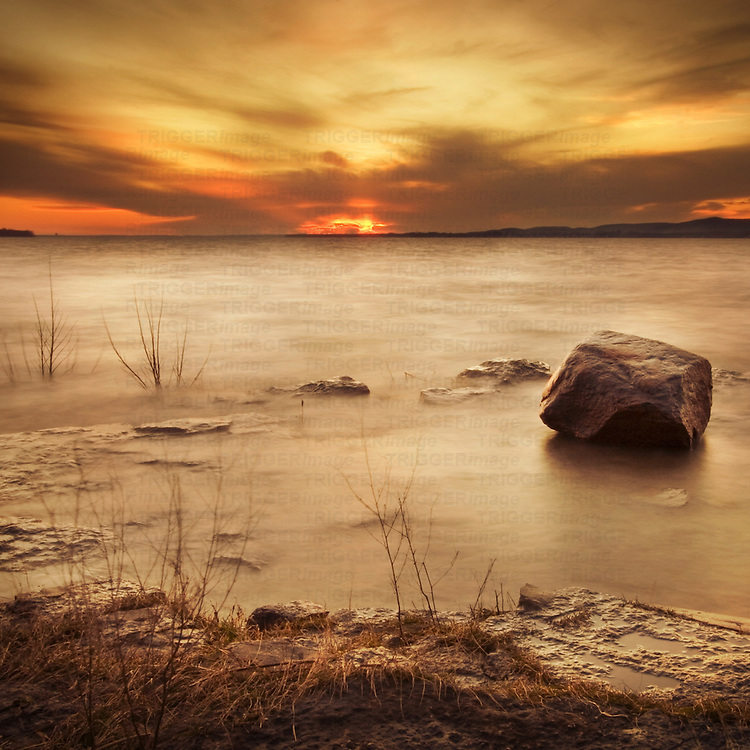 Setting sun over a frozen lake