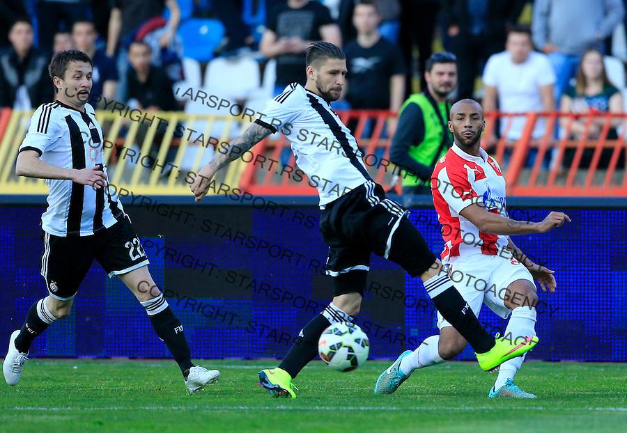 Fudbal Jelen Super League season 2014-2015 Derby Derbi<br /> Crvena Zvezda v Partizan<br /> Joshua Parker (R) Ivan Bandalovski and Sasa Ilic (L)<br /> Beograd, 25.04.2015.<br /> foto: Srdjan Stevanovic/Starsportphoto&copy;