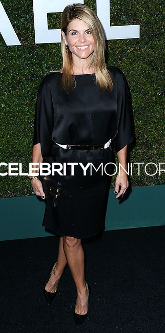 BEVERLY HILLS, CA, USA - OCTOBER 02: Lori Loughlin arrives at Michael Kors Launch Of Claiborne Swanson Franks's 'Young Hollywood' Book held at a Private Residence on October 2, 2014 in Beverly Hills, California, United States. (Photo by Xavier Collin/Celebrity Monitor)