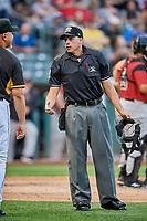 Home plate umpire Paul Clemons handles the calls at the plate between the Sacramento River Cats and the Salt Lake Bees at Smith's Ballpark on May 17, 2018 in Salt Lake City, Utah. Salt Lake defeated Sacramento 12-11. (Stephen Smith/Four Seam Images)