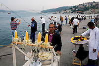 ISTANBUL - MAY 25, 2007:   Corn sellers on the side of the Bosphorus in Istanbul, Turkey. Photo by Landon Nordeman.
