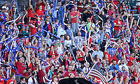Portland, Oregon - Saturday July 2, 2016: Thorns supporters toss streamers into the air during a regular season National Women's Soccer League (NWSL) match at Providence Park.