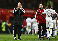 Swansea City caretaker manager Alan Curtis thanks the fans at the end of the game during the Barclays Premier League match between Manchester United and Swansea City played at Old Trafford, Manchester on January 2nd 2016