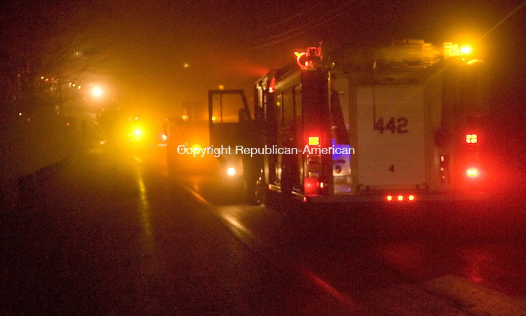 SOUTHBURY, CT- 26 NOV 2007- 112607JT15-<br /> A section of Lakeside Road in Southbury was closed to traffic as emergency vehicles lined the road on Monday evening due to a fire at 20 Sleepy Hollow Rd.<br /> Josalee Thrift / Republican-American