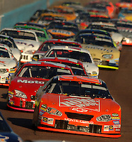 Nov 13, 2005; Phoenix, Ariz, USA;  Nascar Nextel Cup driver Tony Stewart leads a pack of cars at the Checker Auto Parts 500 at Phoenix International Raceway. Tony extended his points lead going into the final race at Homestead, Fla. Mandatory Credit: Photo By Mark J. Rebilas