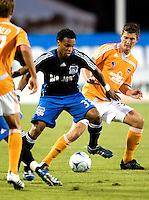 13 September 2008: Scott Sealy of the Earthquakes dribbles the ball through Dynamo defenders during the game at Buck Shaw Stadium in Santa Clara, California.   San Jose Earthquakes tied Houston Dynamo, 1-1.