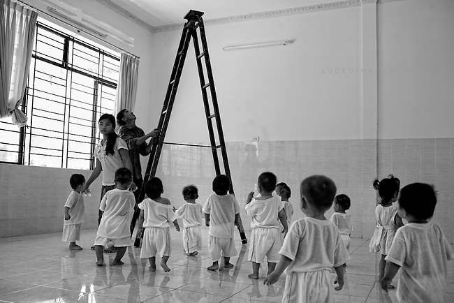 """Dozens of """"saved"""" children roam the halls of an orphanage outside of Nha Trang. Their mothers were talked out of abortions but they did not want to keep them."""