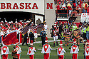 11 September 2010: Nebraska's P.J. Mangieri (92) carries an American flag along side police officers and firefighters in the pre-game to remember 9/11 in the game against Idaho at Memorial Stadium in Lincoln, Nebraska.