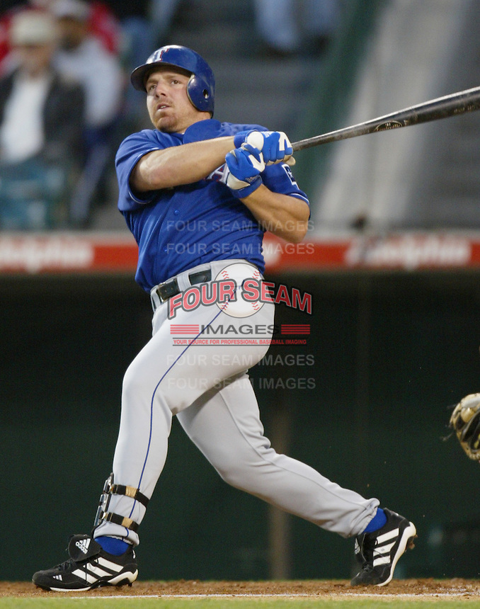 Kevin Mench of the Texas Rangers bats during a 2002 MLB season game against the Los Angeles Angels at Angel Stadium, in Los Angeles, California. (Larry Goren/Four Seam Images)