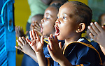 Children clap as they sing during class in a day care center in Monrovia, Liberia, sponsored by United Methodist Women.