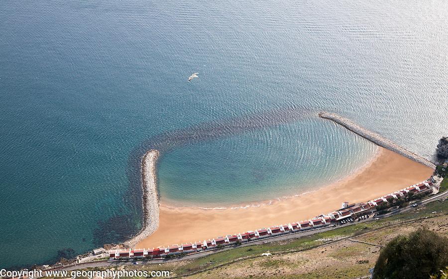 Sandy bay beach created by rock groynes, Gibraltar, British terroritory in southern Europe