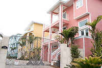 Gated pink yellow and blue homes on the Gulf beach.  Indian Rocks Beach Tampa Bay Area Florida USA