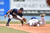 Rome Braves second baseman Omar Obregon (2) fields the ball and tags out Luis Jean (3) during a game against the Asheville Tourists on July 26, 2015 in Asheville, North Carolina. The Tourists defeated the Braves 16-4. (Tony Farlow/Four Seam Images)
