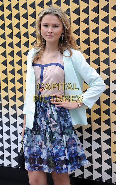 Amber Atherton .at London Fashion Week, Somerset House, London, England, UK,.18th February 2012 .LFW half length  blue beige print dress hand on hip jacket white 3/4 .CAP/WIZ.© Wizard/Capital Pictures.