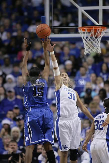 UK's Samantha Drake tries to block a shot from Duke's Richa Jackson at Rupp Arena on Thursday, Dec. 8, 2011. Photo by Scott Hannigan | Staff