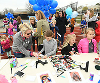 NWA Democrat-Gazette/ANDY SHUPE<br /> Students and parents write letters to the family of Aaron Benton Thursday, March 16, 2017, at the Bob Kraynik Community Sports Complex at the school in Fayetteville. The event was held in remembrance and celebration of Adron, a 6-year-old student at Vandergriff who was found in a nearby swimming pool March 7 and later died.