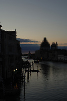 Early morning on the grand canal showing the silhouetted church of San Maria della Salute, with scaffolding on the dome, Venice Italy. May 2007