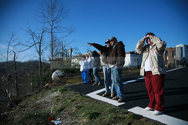 Residents look on at the devastation of West Liberty Ky., from the Appalachian Regional Healthcare's helicopter landing pad in West Liberty, Ky. March 3, 2012. Photo by Brandon Goodwin   Staff