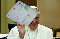 "Papa Francesco riceve un disegno durante l'udienza con i partecipanti all'Incontro Mondiale dei Dirigenti di Scholas Occurentes, nell'Aula del Sinodo, Citta' del Vaticano, 4 settembre 2014.<br /> Pope Francis receives a drawing during his audience to participants in the ""Scholas Occurentes"" executives world meeting, at the Vatican, 4 September 2014.<br /> UPDATE IMAGES PRESS/Riccardo De Luca<br /> <br /> STRICTLY ONLY FOR EDITORIAL USE"