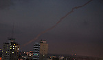 Smoke trails are seen as two rockets are launched from the east Gaza City towards Israel on July 07, 2014. Israeli air strikes on Gaza, that killed at least seven Palestinian militants overnight, came after a day in which armed groups fired at least 25 rockets and mortar rounds at southern Israel. The Gaza violence came as violence raged across annexed east Jerusalem and Arab towns in Israel following the kidnap and murder of a Palestinian teenager in a suspected revenge attack by Jewish extremists who burned him alive. Photo by Ashraf Amra