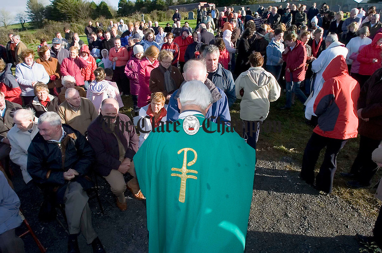 A man of the people......................The Bishop of Killaloe Dr Willie Walsh distributes Holy Communion during the annual Kilmaley Meitheal sponsored Walk Mass and blessing of the new graveyard. Photograph by John Kelly.