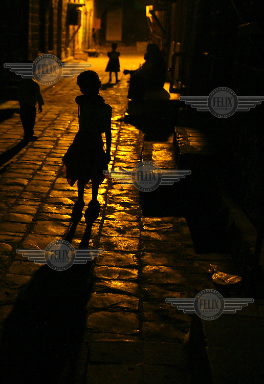 Children on the streets of Aden after dark.