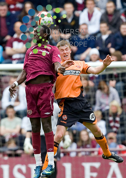 Heart of Midlothian v Dundee Utd., Tynecastle, Edinburgh - 16/05/2009.Scottish Premier League League 2008/09..Hearts' David Obua and Dundee United's Paul Dixon go up for the high ball.  Picture by John Cockburn/ Universal News & Sport (Scotland)