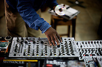 The owner of the Jazz hole, a prominent record store, works on his mixer  in Nigeria's capital Lagos on Saturday March 28 2009..
