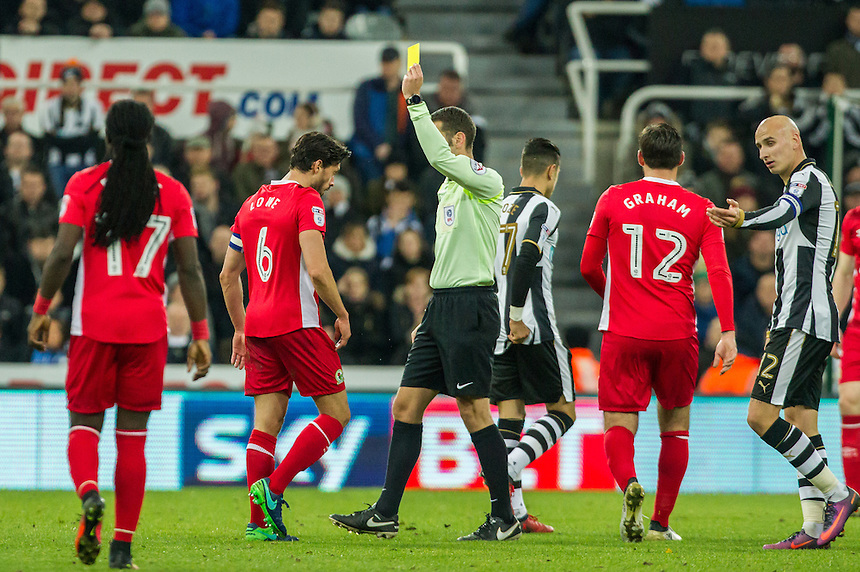 Referee David Coote shows Blackburn Rovers' Jason Lowe the yellow card<br /> <br /> Photographer Alex Dodd/CameraSport<br /> <br /> The EFL Sky Bet Championship - Newcastle United v Blackburn Rovers  - Saturday 26th November 2016 - St James' Park - Newcastle<br /> <br /> World Copyright &copy; 2016 CameraSport. All rights reserved. 43 Linden Ave. Countesthorpe. Leicester. England. LE8 5PG - Tel: +44 (0) 116 277 4147 - admin@camerasport.com - www.camerasport.com