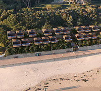 BNPS.co.uk (01202)558833<br /> Pic: JamesMunday/BNPS<br /> <br /> Plans have been unveiled for 28 eco-friendly beach huts to be built into a fragile seaside cliff to protect it from erosion.<br /> <br /> The timber-clad 'pods' will be erected on two tiers hallway up the 80ft sloping seaside cliff near to Sandbanks in Poole, Dorset.<br /> <br /> The stilts will act as pile foundations and be drilled into the ground to improve the stability of the cliff.<br /> <br /> Each beach hut will have its own balcony overlooking the sea and 140sq ft of floor space.<br /> Plans have been submitted to the local council to approve.