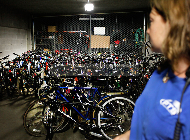 Bike officer Beth Phillips looks at the collection of bikes UK parking has accrued this past summer from July-August at the bike impound in parking structure 5 on Monday, September 13, 2009. Photo by Zach Brake | Staff