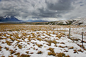 Late spring snow covers the ground at the head of Lake Tekapo with Godley river valley in the distance, Tekapo, Mackenzie District, Canterbury, South Island, New Zealand.