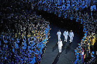 15 MAR 2006 - MELBOURNE, AUSTRALIA - John Landy, Governor of Victoria and former Olympian, carries the torch on its final leg accompanied by Cathy Freeman, Ron Clarke and Marjorie Jackson-Nelson at the Opening Ceremony for the 2006 Commonwealth Games. (PHOTO (C) NIGEL FARROW)