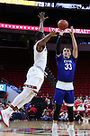 03 November 2016: Lynn's Kevin O'Brien (33) shoots over NC State's Torin Dorn (left). The North Carolina State University Wolfpack hosted the Lynn University Fighting Knights at PNC Arena in Raleigh, North Carolina in a 2016-17 NCAA Division I Men's Basketball exhibition game. NC State won the game 100-66.