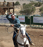 Dan Nalder competes in the double mugging event at the Minden Ranch Rodeo in Gardnerville, Nev., on Sunday, July 22, 2012..Photo by Cathleen Allison