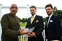 Connections of Lyrica's Lion receive their trophy for winning The Party Continues At The Chapel Nightclub Handicap, during Ladies Evening Racing at Salisbury Racecourse on 15th July 2017