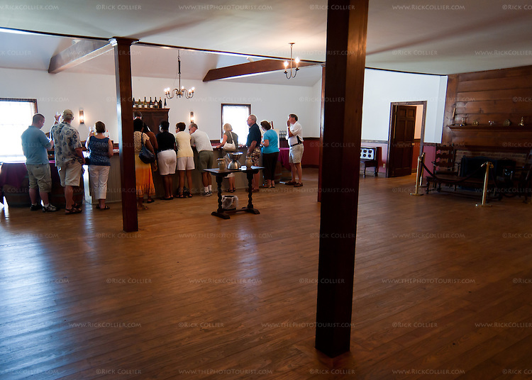 "Like most stores and venues in this colonial town, most rooms at The Williamsburg Winery are styled after the colonial period.  Visitors who pay for the full facility tour will receive their wine tasting in this large tavern-styled room, the ""Susan Constant Hall."""
