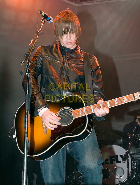 McFLY - DANNY JONES.Blackpool Illuminations - press launch & photocall..Blackpool seafront, Blackpool, Lancashire..September 2nd, 2005.half length stage concert live performance guitar black leather jacket.www.capitalpictures.com.sales@capitalpictures.com.© Capital Pictures.