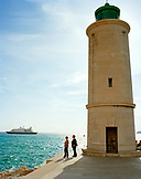 FRANCE, Nice, women by lighthouse next to the Mediterranean Sea