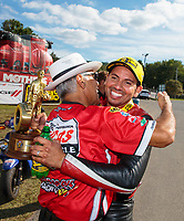 Sep 16, 2018; Mohnton, PA, USA; NHRA pro stock motorcycle rider Hector Arana Jr (right) celebrates with father Hector Arana Sr after winning the Dodge Nationals at Maple Grove Raceway. Mandatory Credit: Mark J. Rebilas-USA TODAY Sports