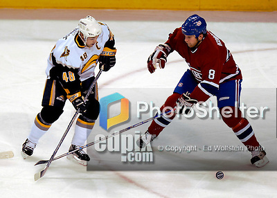 23 October 2006: Buffalo Sabres center, and team captain Daniel Briere (48) tries to get puck control over Montreal Canadiens defenseman Mike Komisarek (8) at the Bell Centre in Montreal, Canada on October 23, 2006. The Sabres defeated the Canadiens 4-1. Mandatory photo credit: Ed Wolfstein Photo.<br />  *** Editorial Sales through Icon Sports Media *** www.iconsportsmedia.com